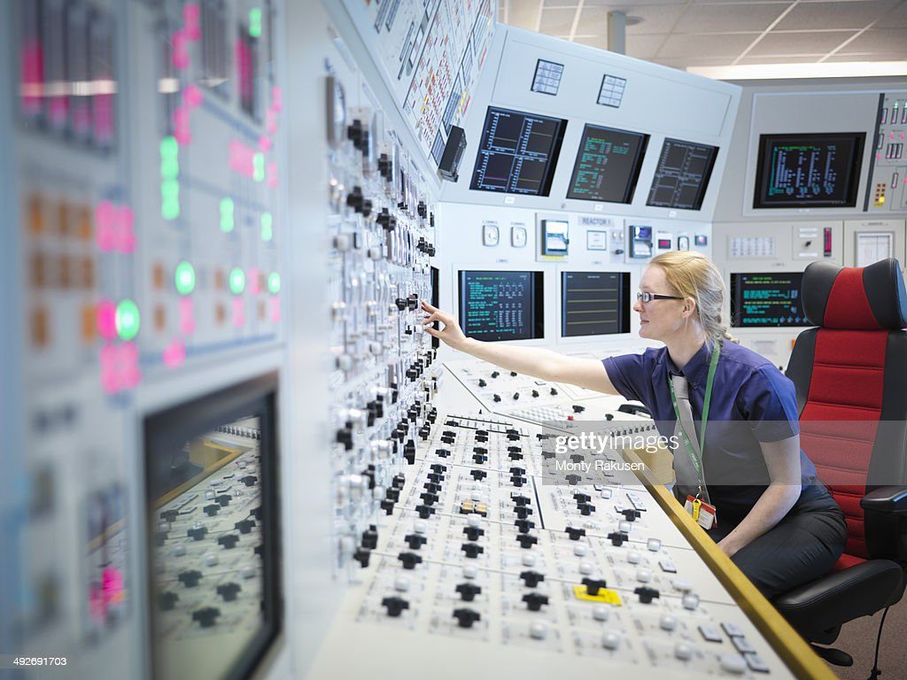 Female operator in nuclear power station control room simulator : Stock Photo