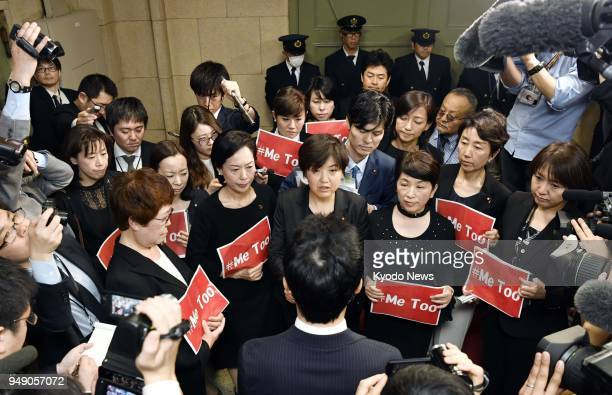 Female opposition lawmakers visit the Finance Ministry to protest against its top bureaucrat's alleged sexual harassment of a female reporter holding...
