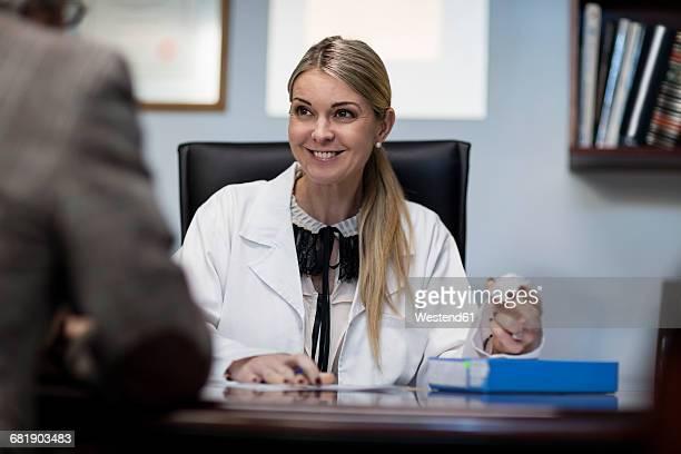Female optometrist talking to patient