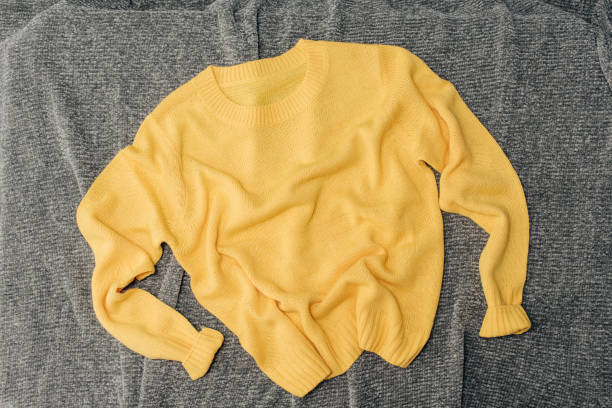 Female orange knitted sweater on white background top view flat lay. Fashion Lady Clothes Set Trendy Cozy Knit Jumper Autumn accessories. Female fashion look
