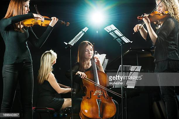 female orchestra. - musical quartet stock photos and pictures