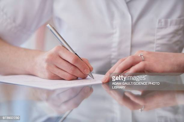 Female osteopath making notes