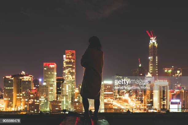 Female overlooking the stunning view of city