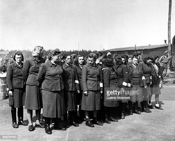 Female overseers at BergenBelsen concentration camp having been taken prisoner by the British 17th April 1945 60000 civilian prisoners many suffering...
