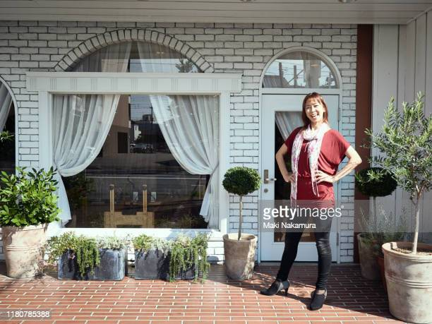 female owner standing in front of pilates studio - maebashi city stock photos and pictures