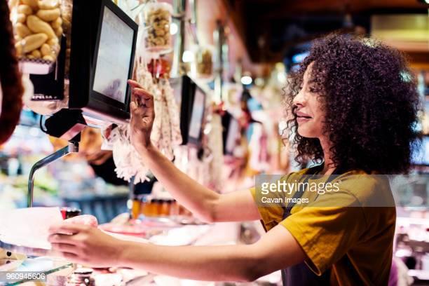 Female owner using desktop computer in shop