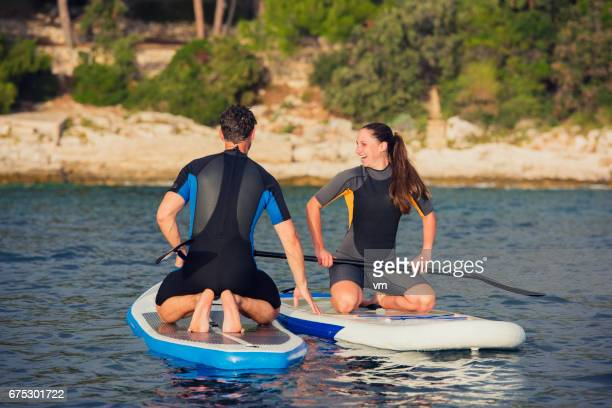 Female paddleboarder smiling and laughing