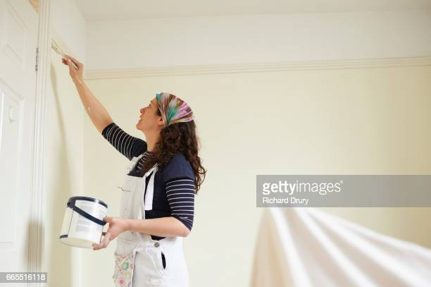 female painter and decorator painting with brush - richard drury stock pictures, royalty-free photos & images