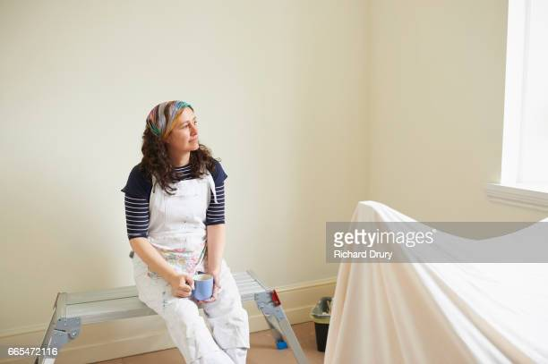female painter and decorator taking a break - richard drury stock pictures, royalty-free photos & images