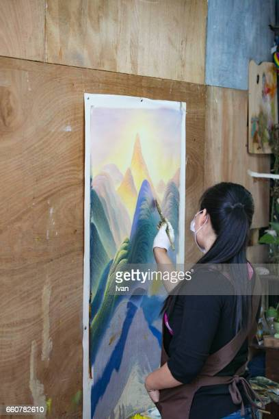A Female Painter Drawing a Landscape Oil Painting
