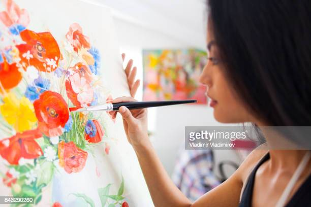 Female painter drawing in her studio