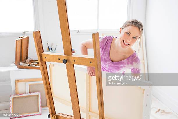 Female painter in studio, Jersey City, New Jersey, USA