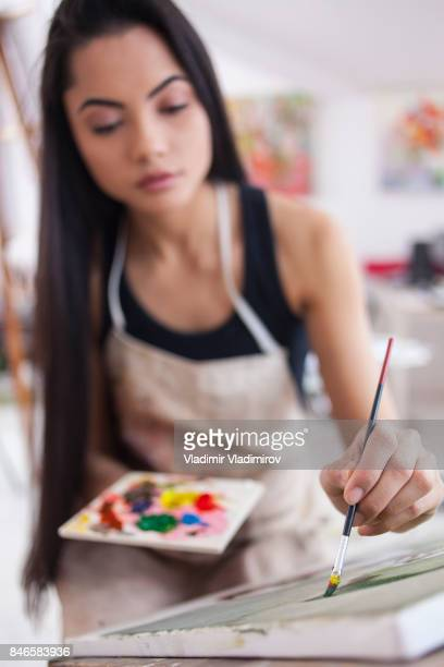 Female painter in workshop