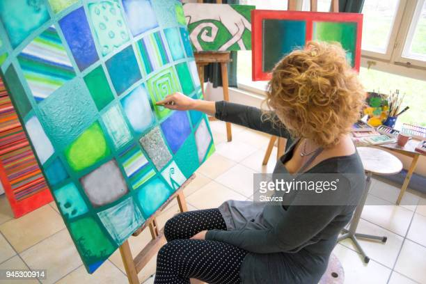 female painter painting abstract painting - chalk art equipment stock pictures, royalty-free photos & images