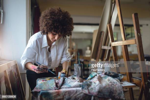 female painter - art stock pictures, royalty-free photos & images