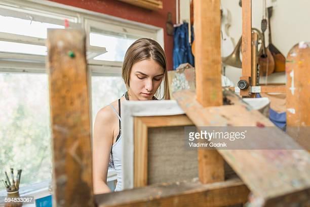 Female painter working in studio