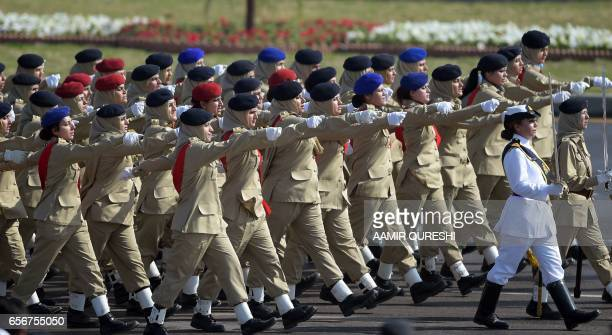 Female Pakistani soldiers march past during a Pakistan Day military parade in Islamabad on March 23 2017 Pakistan National Day commemorates the...