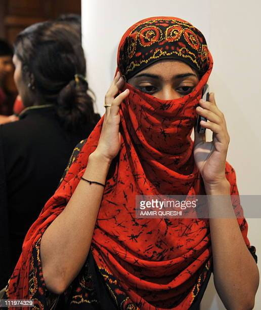Female Pakistani student evacuated from Kyrgyzstan talks on mobile phone to a parent as she arrives at the military Chaklala airbase in Rawalpindi on...