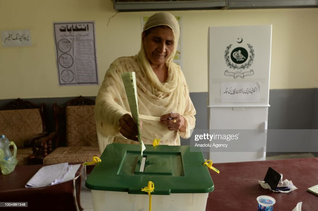 A female Pakistani voter casts her ballot at a polling station in Rawalpindi Pakistan on July 25 2018 Millions of Pakistanis will vote on Wednesday...