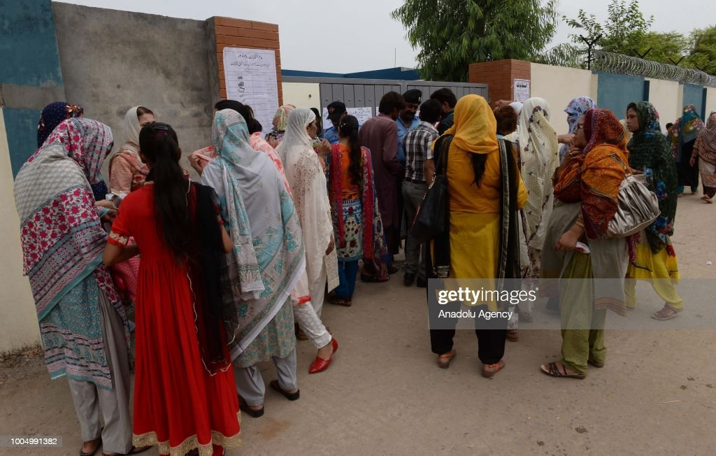 Female Pakistani voters are seen outside a polling station as they arrive to their ballots in Rawalpindi Pakistan on July 25 2018 Millions of...