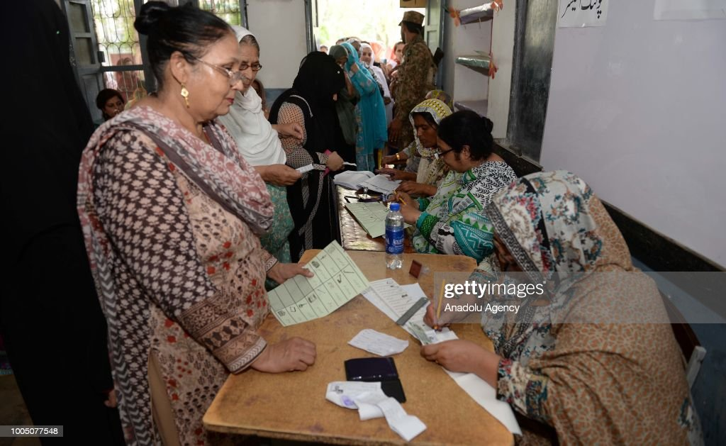 Female Pakistani voters arrive get their ballot papers to cast their votes at a polling station in Rawalpindi Pakistan on July 25 2018 Millions of...