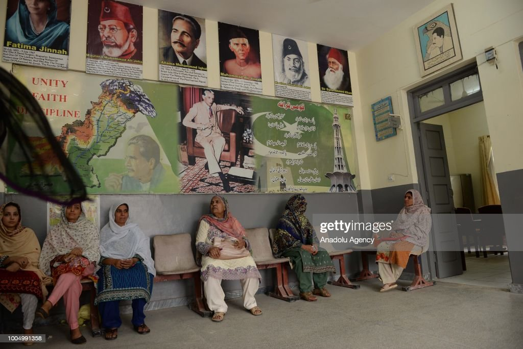 Female Pakistani voters wait for their turn to cast their ballots at a polling station in Rawalpindi Pakistan on July 25 2018 Millions of Pakistanis..