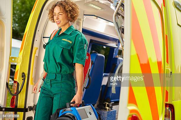 female paramedic leaving the ambulance - sturti stock pictures, royalty-free photos & images
