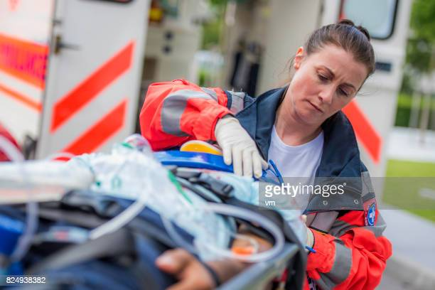 female paramedic with patient - rescue services occupation stock pictures, royalty-free photos & images