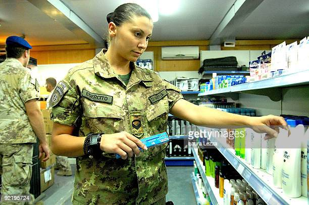 A female paratrooper of the Folgore Parachute Brigade shops in the market place inside Camp Arena military base on September 14 2009 in Herat...