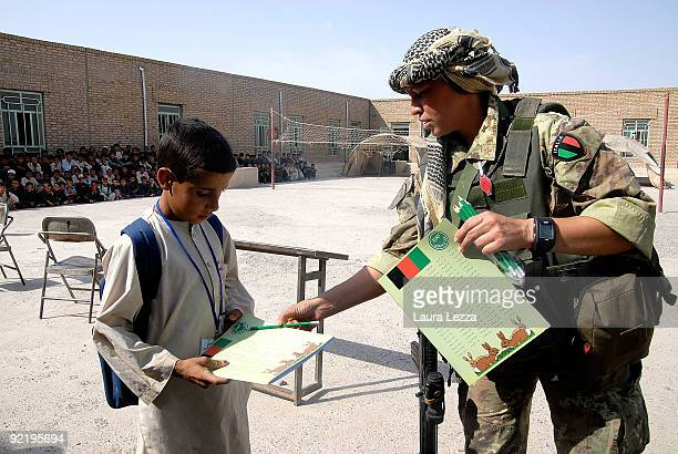 A female paratrooper soldier of the Folgore Parachute Brigade inside a children school on September 16 2009 in Shindand Afghanistan During these...