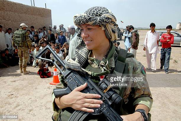 A female paratrooper soldier of the Folgore Parachute Brigade stands near a children school on September 16 2009 in Shindand Afghanistan During these...