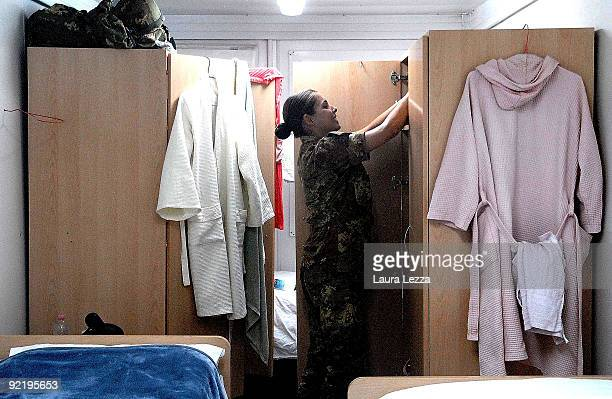 A female paratrooper soldier of the Folgore Parachute gets ready inside her bedroom in the female quarters in Camp Arena on September 20 2009 in...