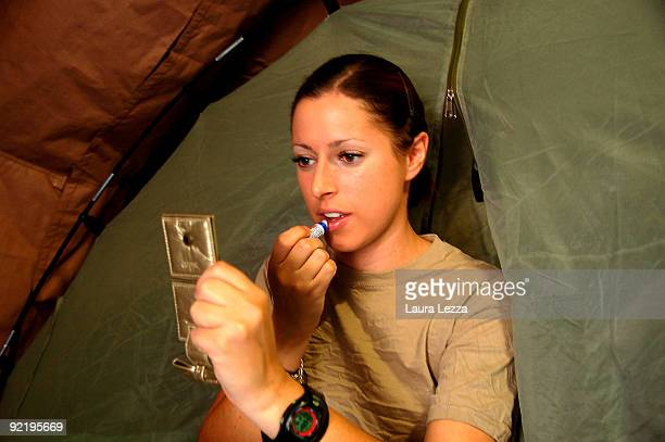 A female paratrooper soldier of the Folgore Parachute puts on some make up in her tent in the morning on September 17 2009 in Shindand Afghanistan...