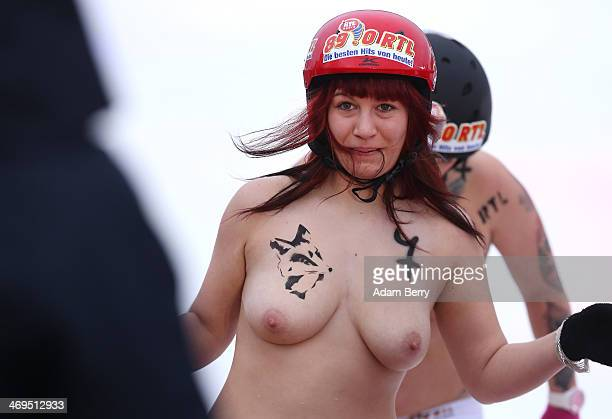 A female participant finishes her run in the 2014 Naked Sledding World Championships on February 15 2014 in Hecklingen near Magdeburg Germany The...