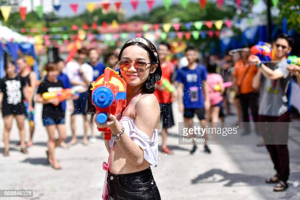 Female participant pictured during Songkran Music Festival 2017 celebrations in Kuala Lumpur Malaysia on April 14 2017