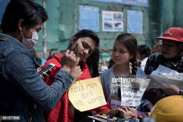 A female participant seen having her face painted The international women's day is being celebrated in Kathmandu with hundreds of women taking part...