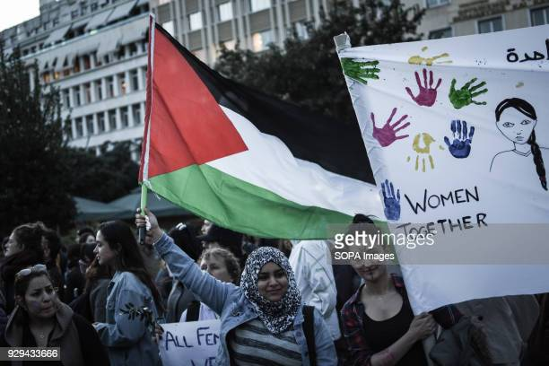 """Female participant seen holding a Palestinian flag during the demonstration. Hundreds of women participated in the demonstration of """"anti-sexism and..."""