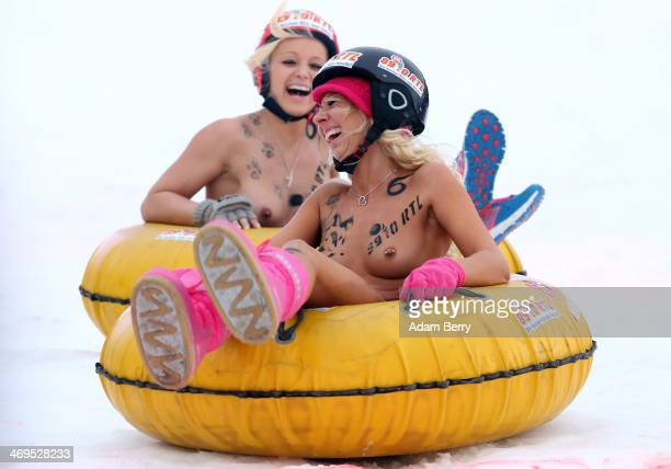Female participants compete in the 2014 Naken Sledding World Championships on February 15 2014 in Hecklingen near Magdeburg Germany The annual event...
