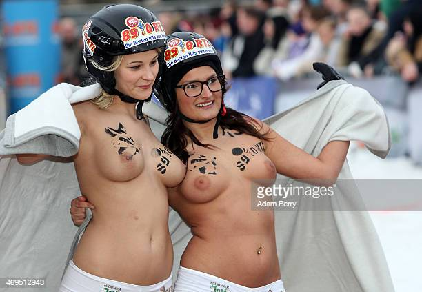Female participants finish their run in the 2014 Naked Sledding World Championships on February 15 2014 in Hecklingen near Magdeburg Germany The...