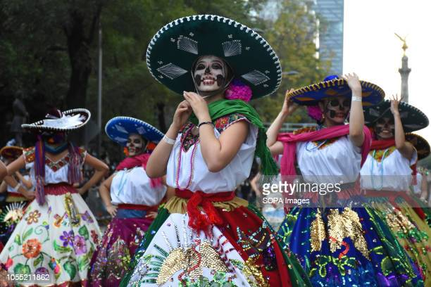Female participants seen during the parade People take part at the annual Day of the Dead Parade as part of the celebrations of Mexico's Day of the...
