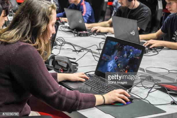 A female participants seen playing online game on a laptop The biggest game convention Paris Games Week took place at Paris Expo The event open to...