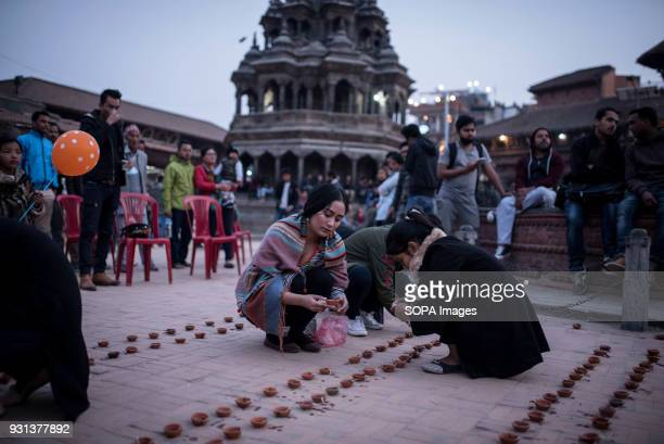 Female participants seen preparing the candles to be lit at night The international women's day is being celebrated in Kathmandu with hundreds of...