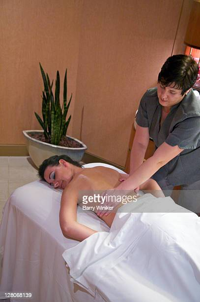female passenger getting a massage aboard holland america line's westerdam, february 2010 - westerdam stock pictures, royalty-free photos & images