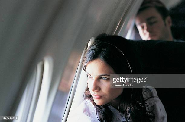 Female Passenger Looking Through an Aeroplane Window