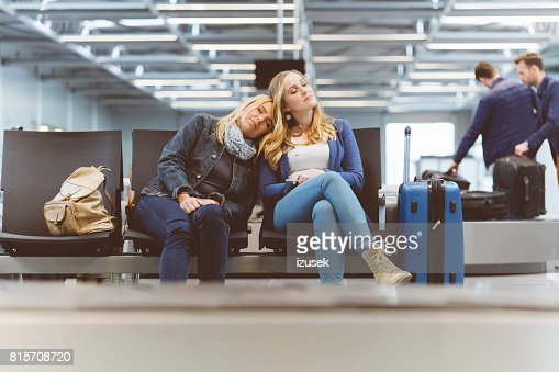 Female passengers sleeping at the airport lounge