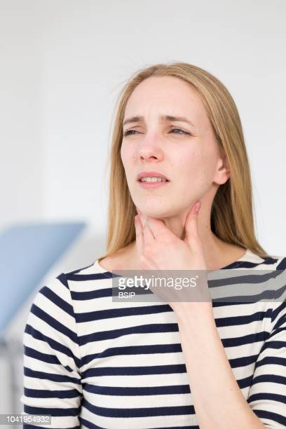 Female patient consulting for sore throat