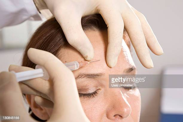 Female patient having a Botox injection