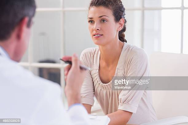 Female patient listening to doctor with concentration
