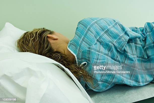 Female patient lying on side on examination table