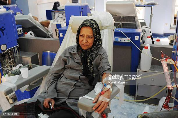 A female patient seen while undergoing dialysis treatment in a special ward set up by the charity 'Foundation For Special Diseases' on June 10 2013...